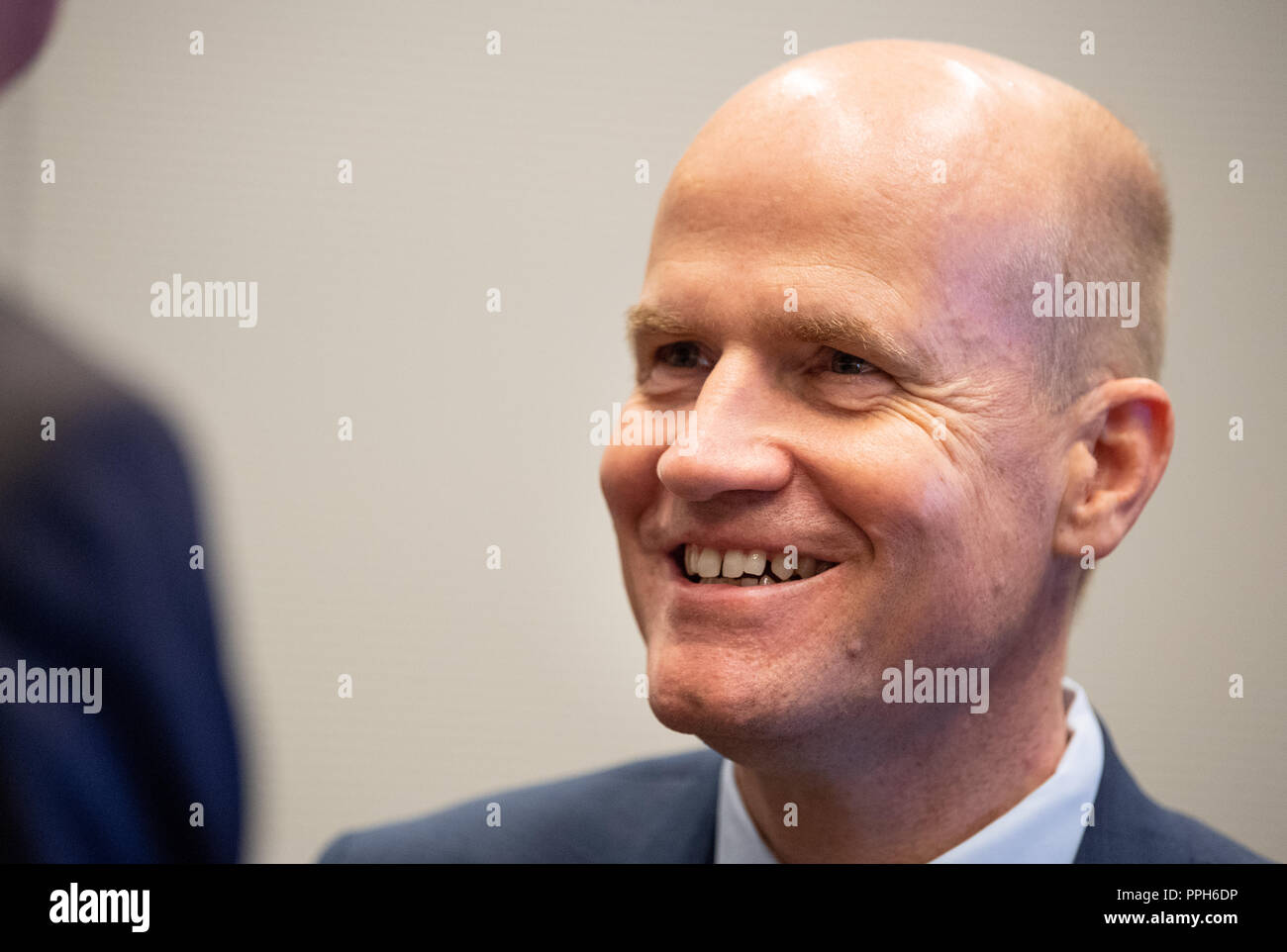 26 September 2018, Berlin: Ralph Brinkhaus (CDU), leader of the parliamentary group, arrives at an event 'Heimat mit Zukunft'- für starken ländliche Regionen' in the session hall of the CDU/CSU parliamentary group in the Bundestag. Photo: Fabian Sommer/dpa - Stock Image