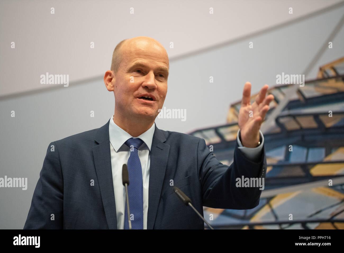 26 September 2018, Berlin: Ralph Brinkhaus (CDU), CDU/CSU faction leader, speaks at an event 'Heimat mit Zukunft'- für starken ländliche Regionen' (Homeland with a Future - for Strong Rural Regions) in the session hall of the CDU/CSU faction in the Bundestag. Photo: Fabian Sommer/dpa - Stock Image