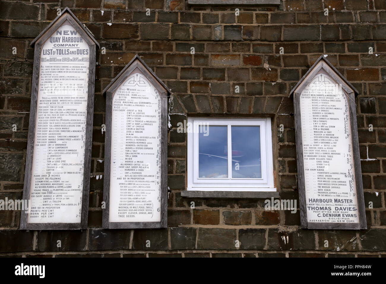 Old tolls and dues signs, New Quay Harbour, Cardigan Bay, Ceredigion, Wales, Great Britain, United Kingdom, UK, Europe - Stock Image