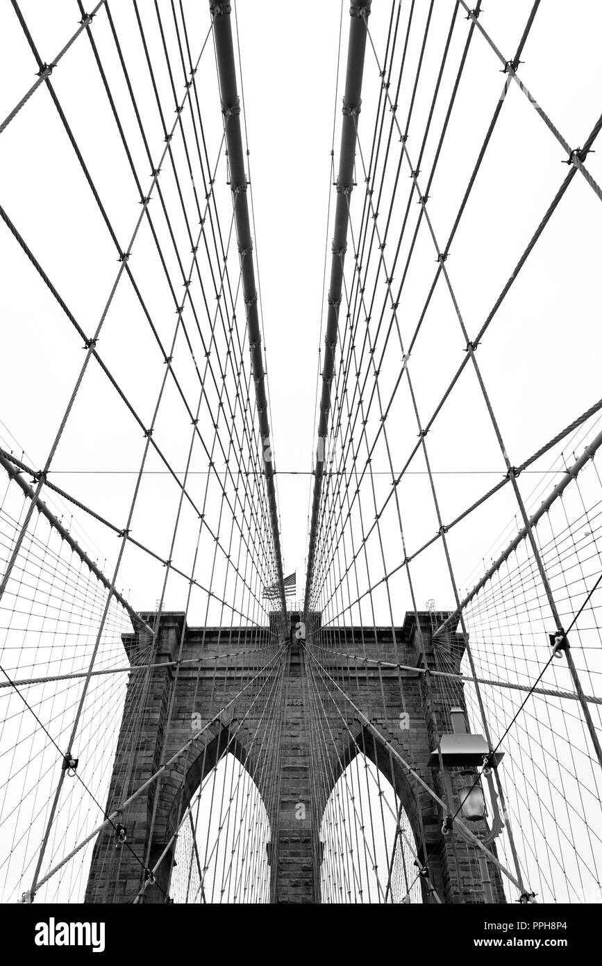 Black and white wide angle view of the Brooklyn Bridge in New York City. - Stock Image