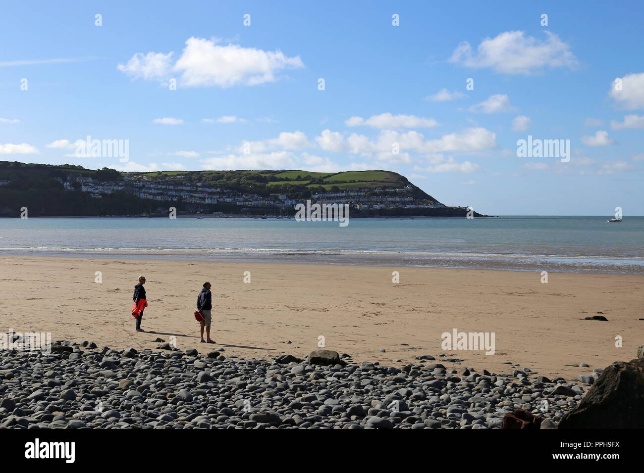 Beach at Llanina Point with New Quay beyond, New Quay, Cardigan Bay, Ceredigion, Wales, Great Britain, United Kingdom, UK, Europe - Stock Image