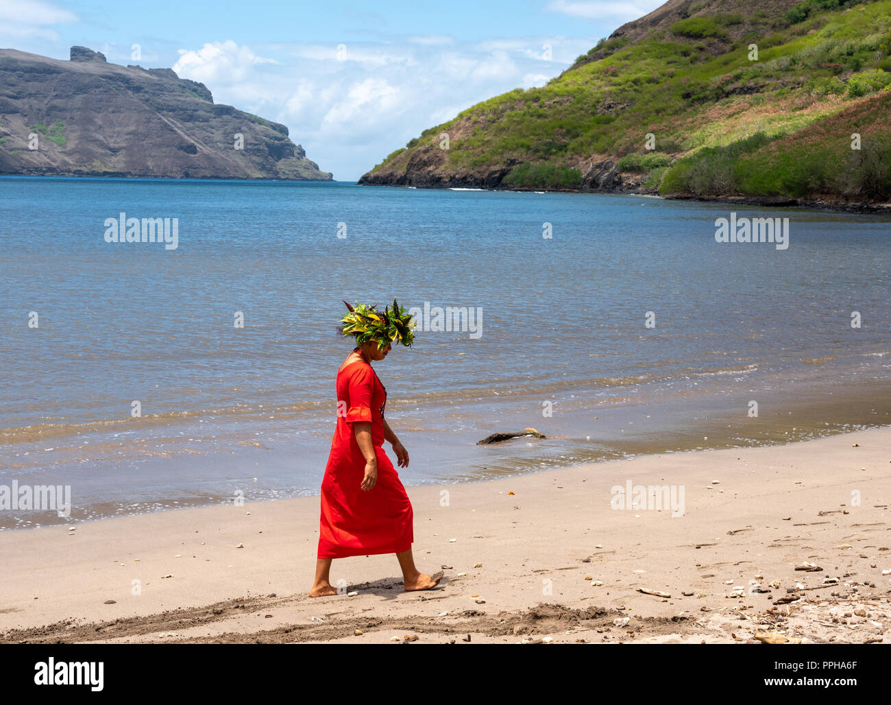 Nuku Hiva, French Polynesia -- March 23, 2018. Native tour guide walks on a beach in Nuku Hiva in the South Pacific. - Stock Image