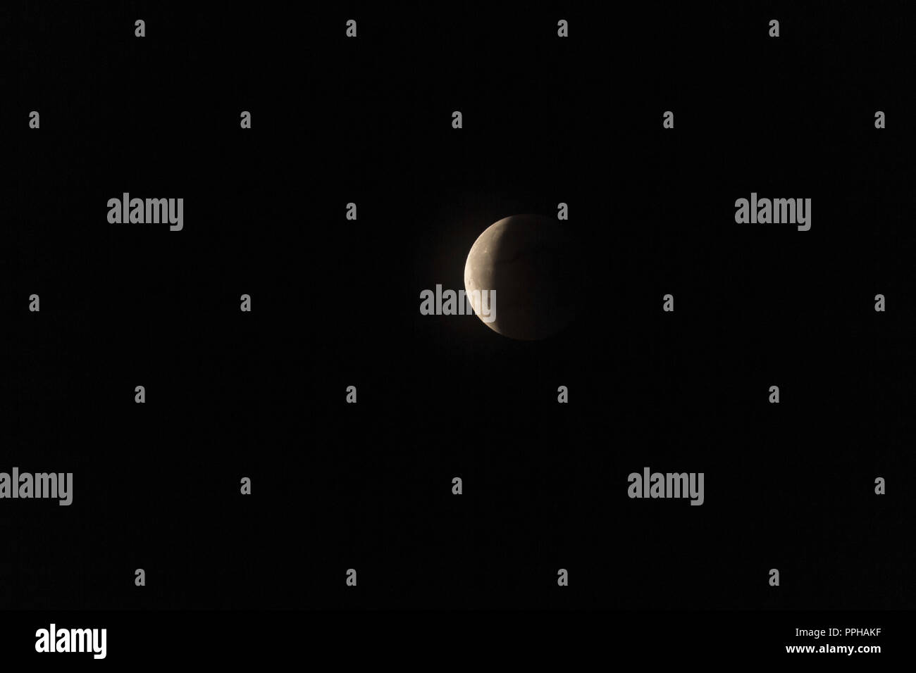 Total lunar eclipse and Mars opposition - Stock Image