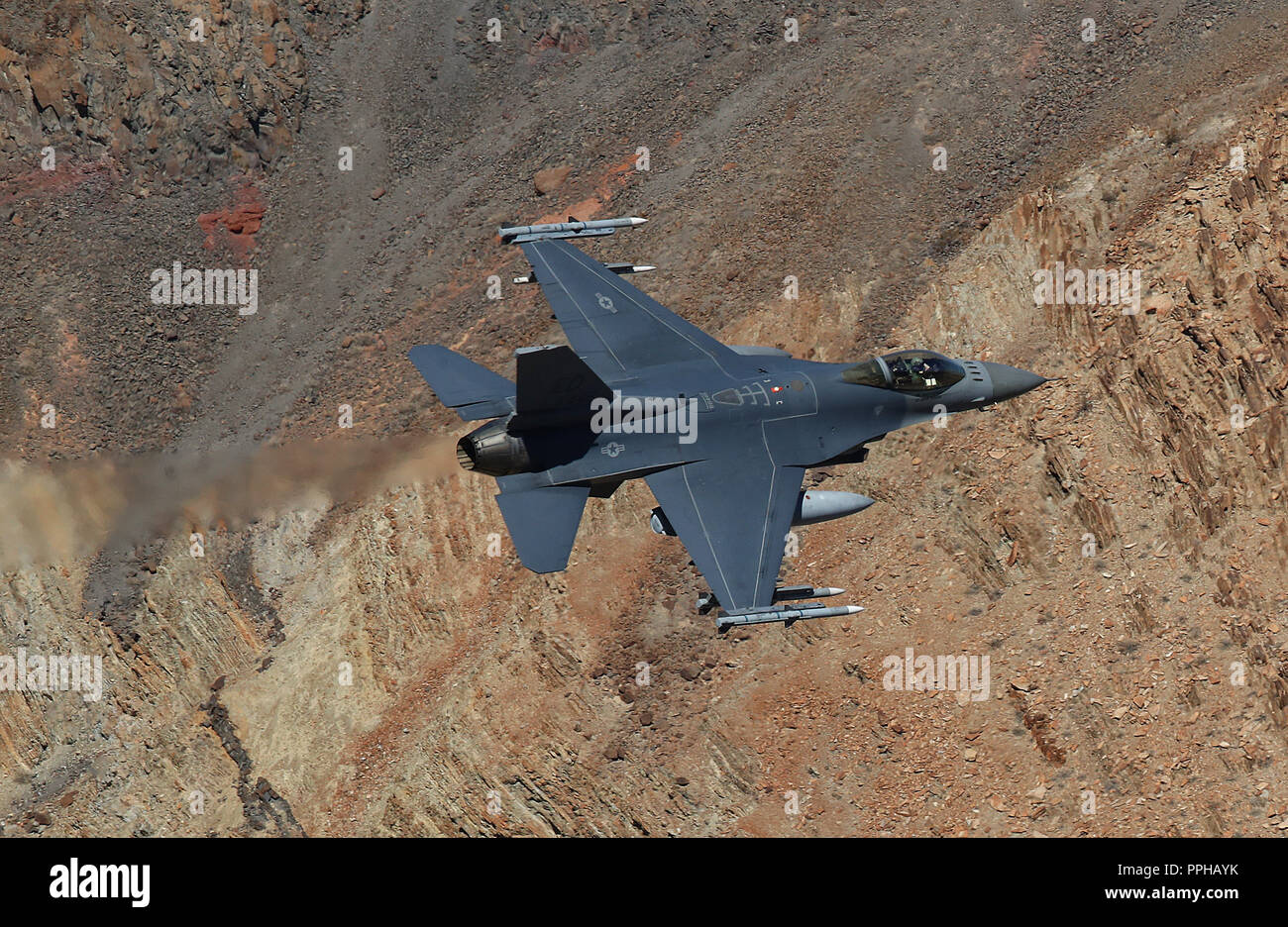 US Air Force F-16C Fighting Falcon from Edwards AFB flies a low level sortie through Star Wars canyon on Jedi transition in Death Valley CA Stock Photo