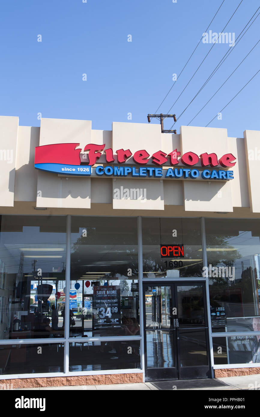 Firestone Complete Auto Care Center Sign On Exterior Of Building In