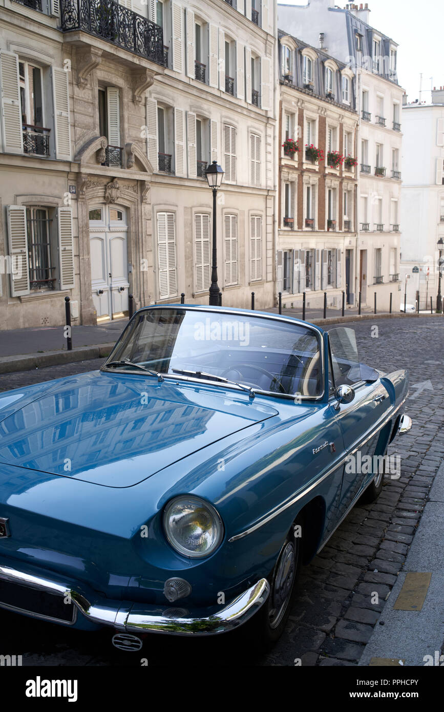 Renault convertible old-timer parked on street in Montmartre, Paris - Stock Image