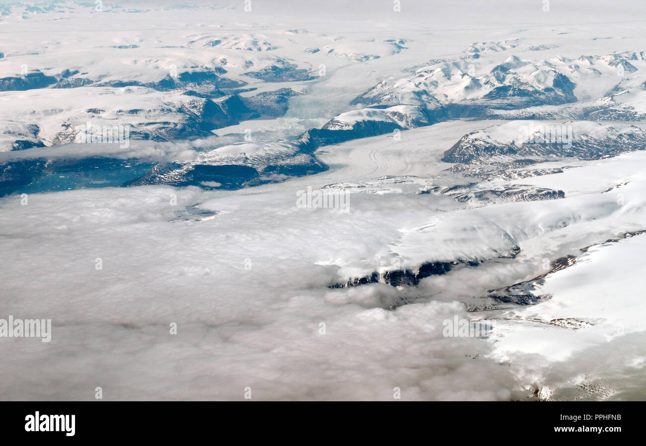 Aerial view of Greenland and it's terrain including glaciers, waterways, ice and snow - Stock Image