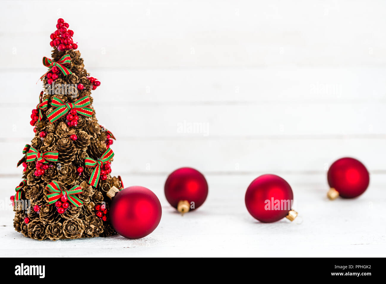 Christmas card with red ornaments and christmas tree on wooden ...