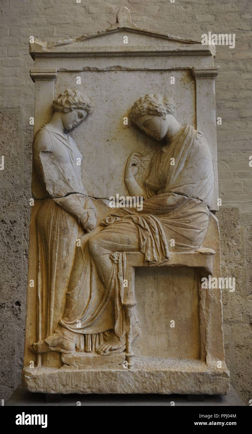 Greek art. Grave relief of Mnesarete. About 380 BC. The dead woman is seated in front of a sorrowing girl. The name is recorded on the pediment Mnesarete (daughter) of Socrates. Glyptothek. Munich. Stock Photo