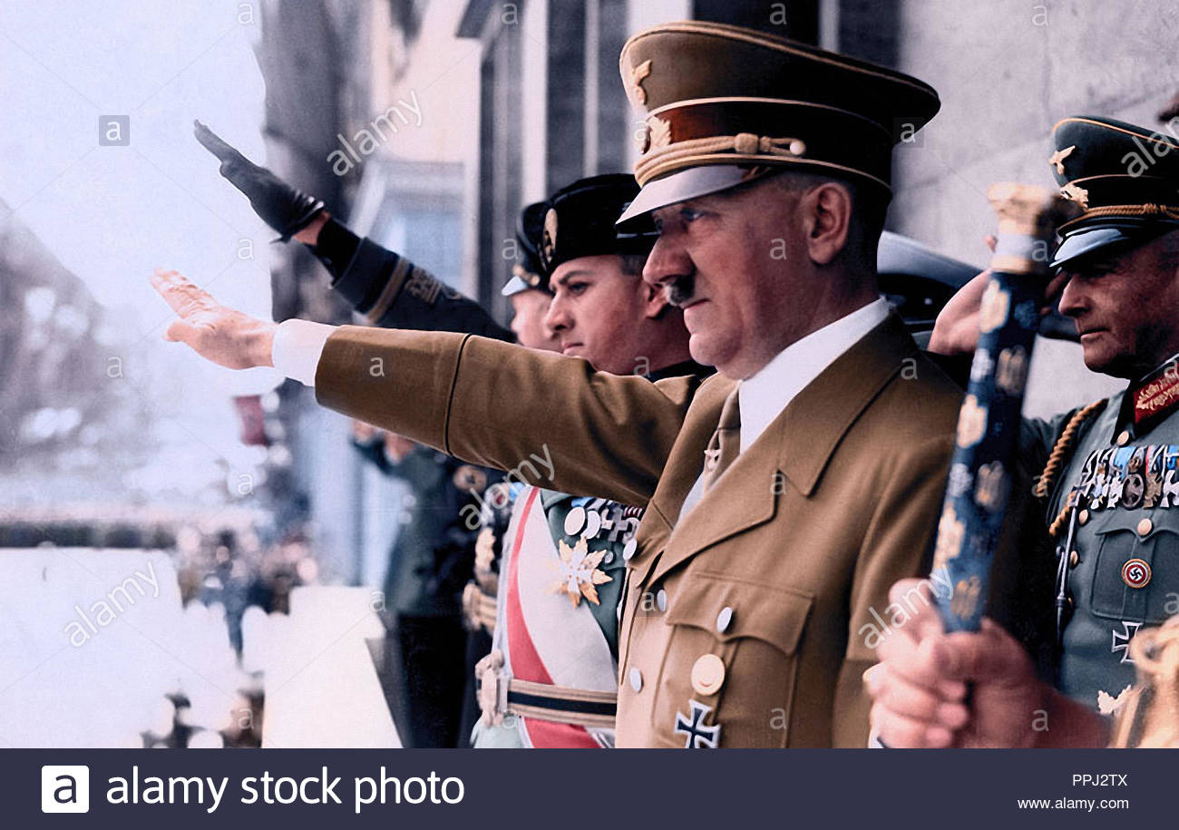Adolf Hitler with Mussolini's son-in-law and Joachim von Ribbentrop, at a Nazi Party rally, 1930s - Stock Image