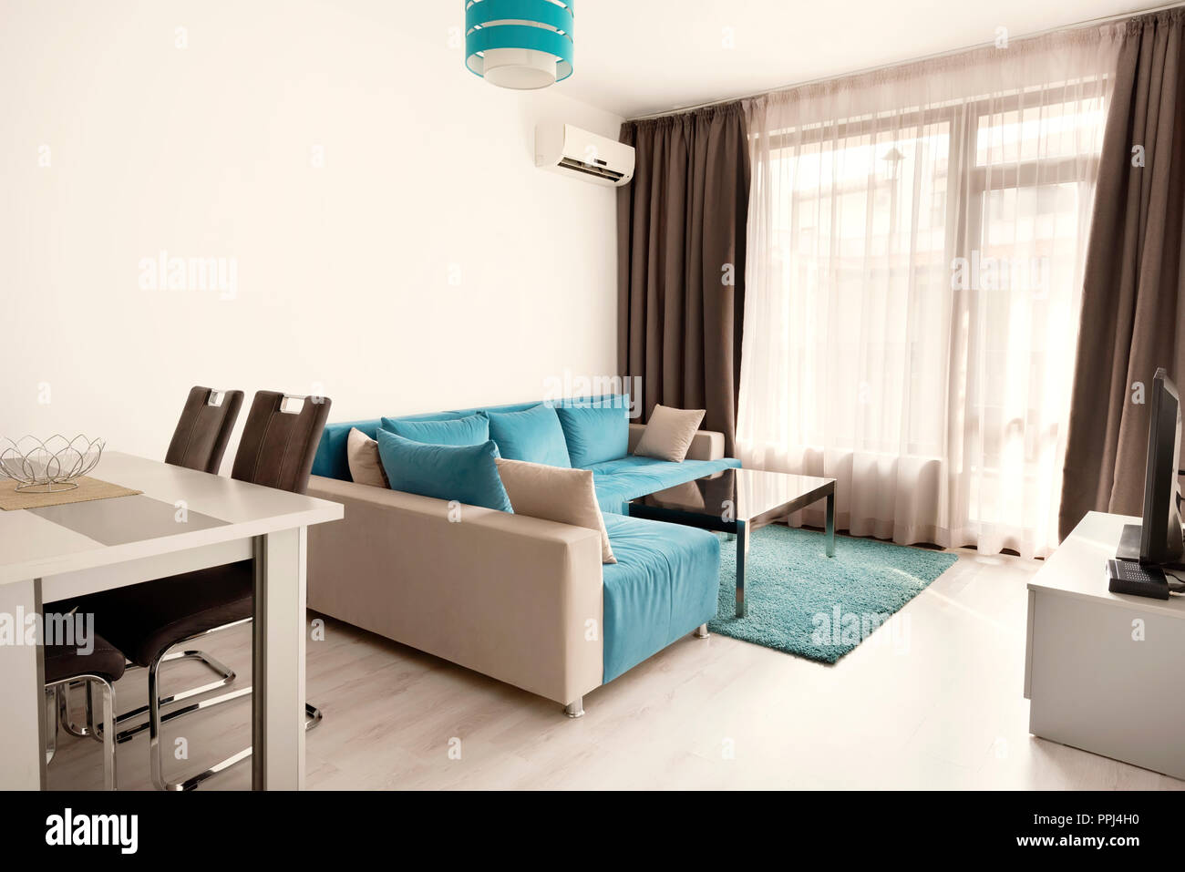 Modern bright and cozy living room interior design with sofa ...