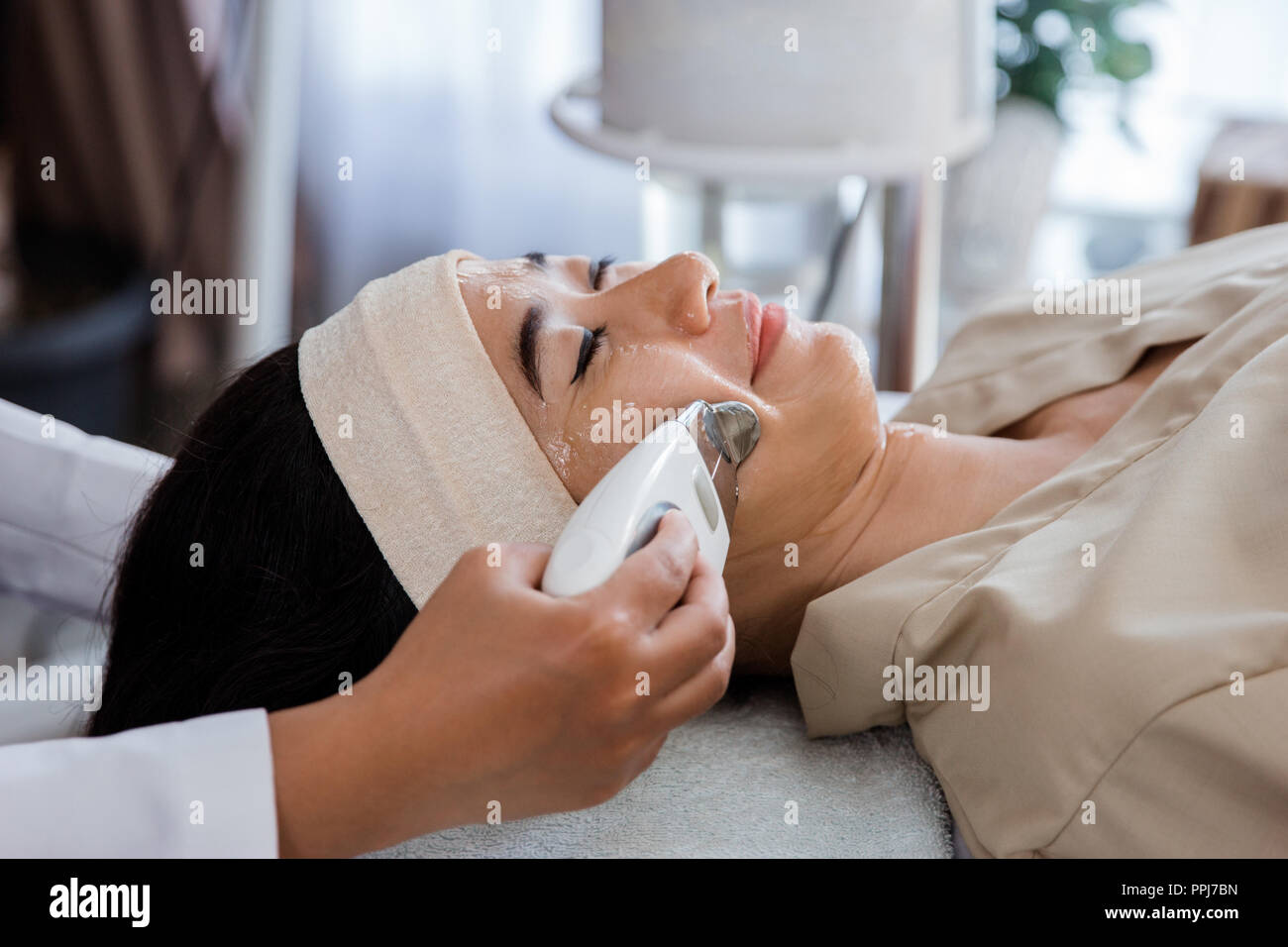 Picture of beautician doing rf procedure - Stock Image