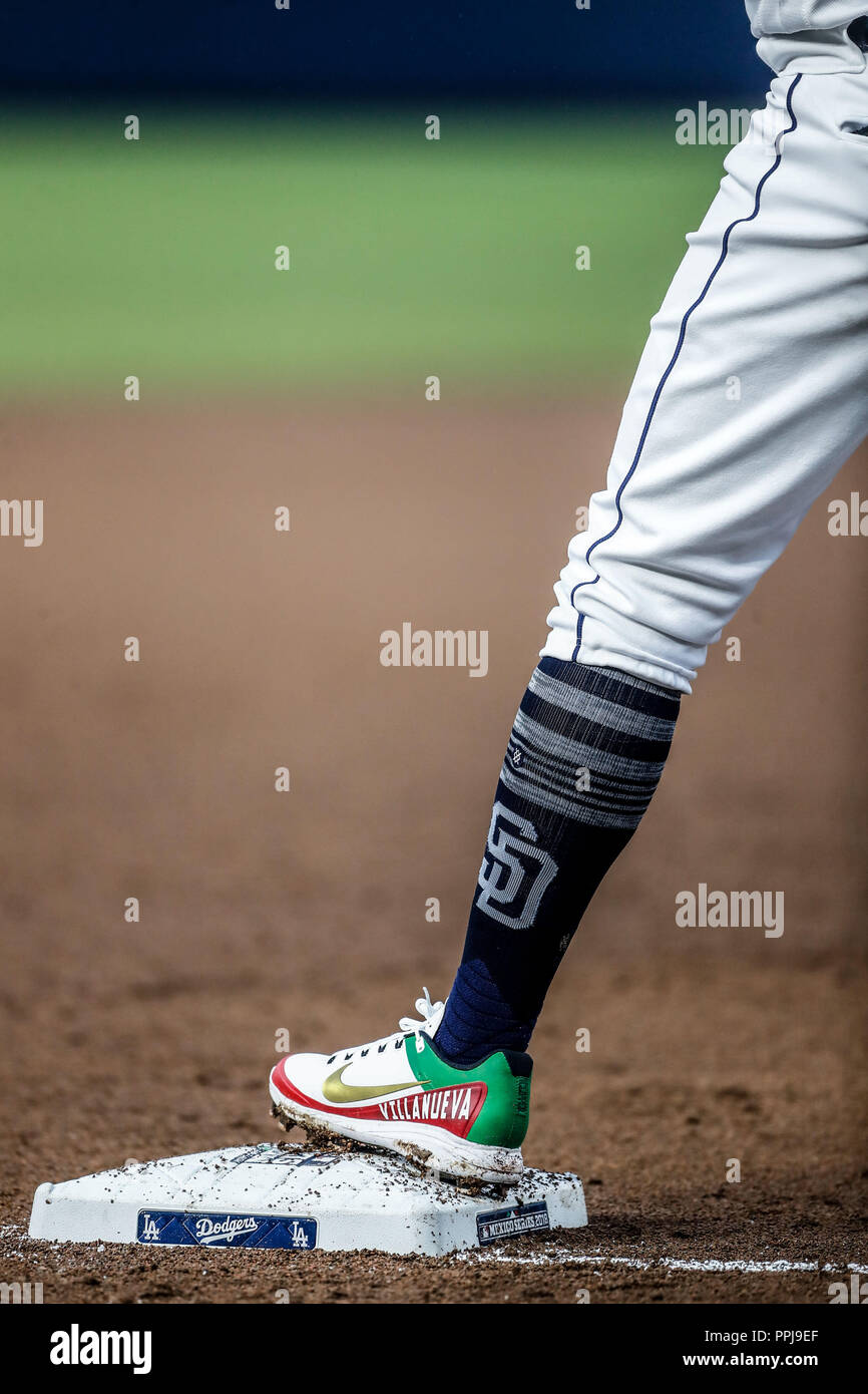 spikes de Christian Villanueva con los colores y la bandera de mexico.  Baseball action during the Los Angeles Dodgers game against San Diego Padres,  - Stock Image