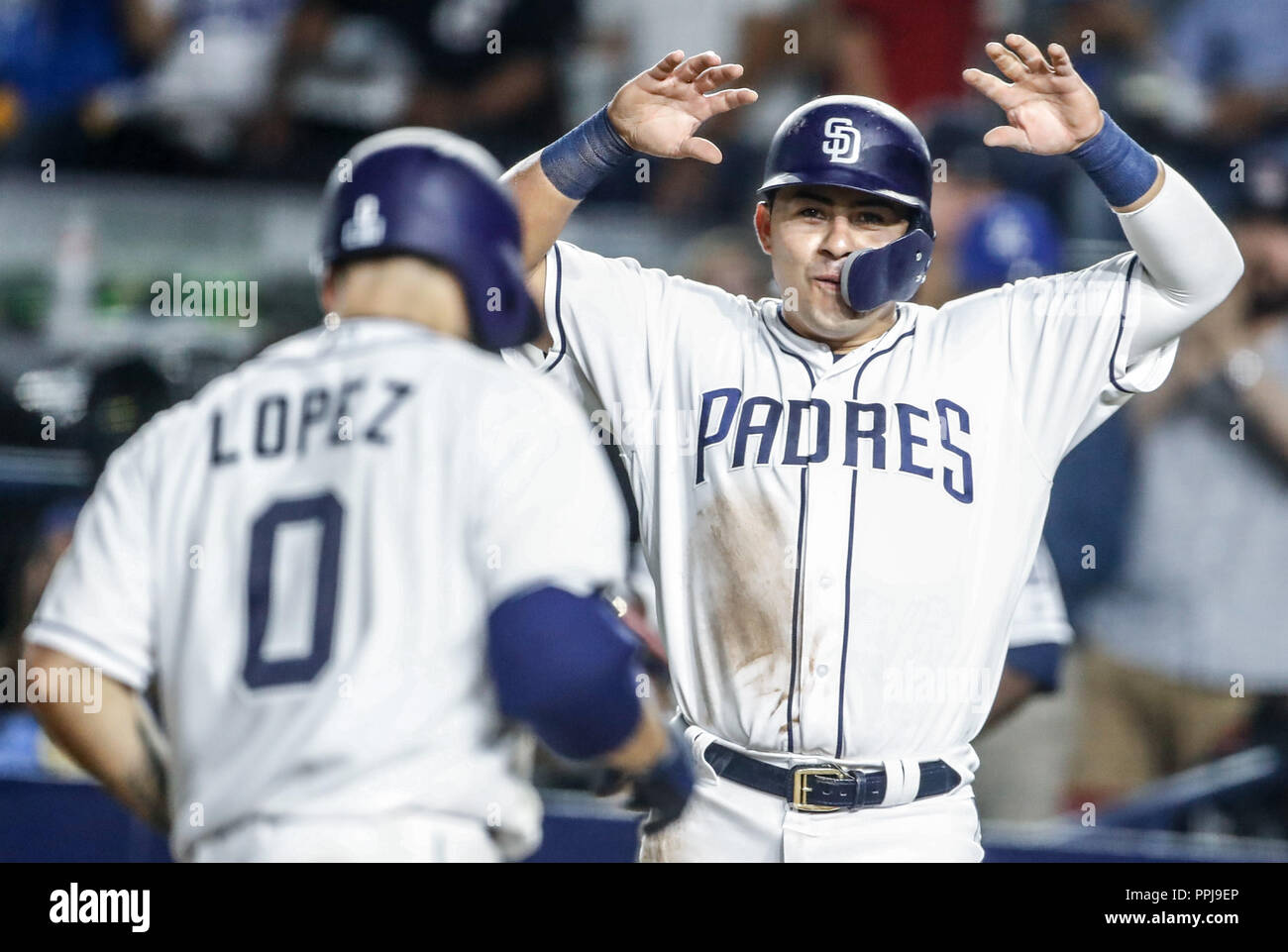 Raffy Lopez celebra homerun con Christian Villlanueva. Baseball action during the Los Angeles Dodgers game against San Diego Padres, the second game o - Stock Image