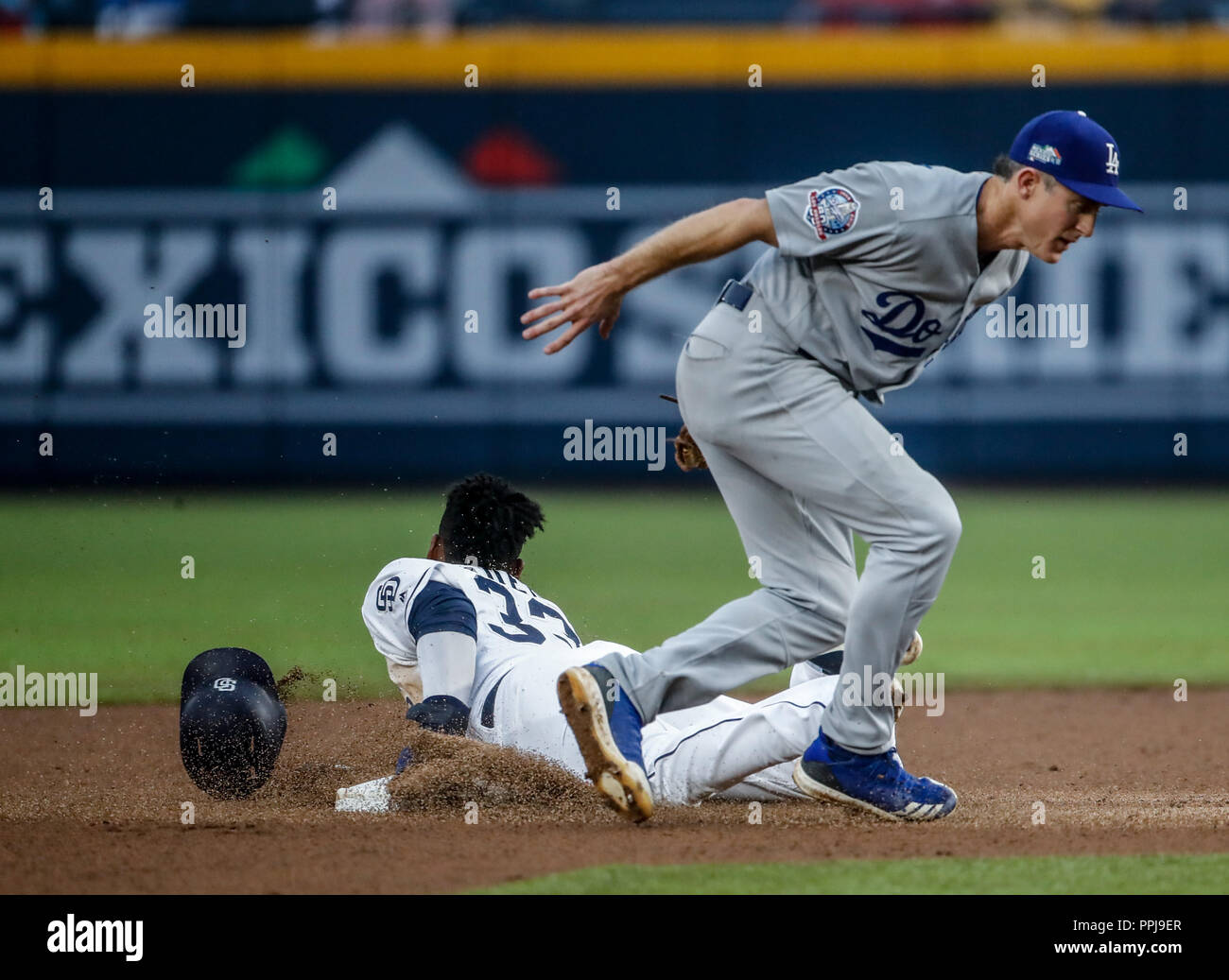 Franchy Cordero and Chase Utley. Baseball action during the Los Angeles Dodgers game against San Diego Padres, the second game of the Major League Bas - Stock Image