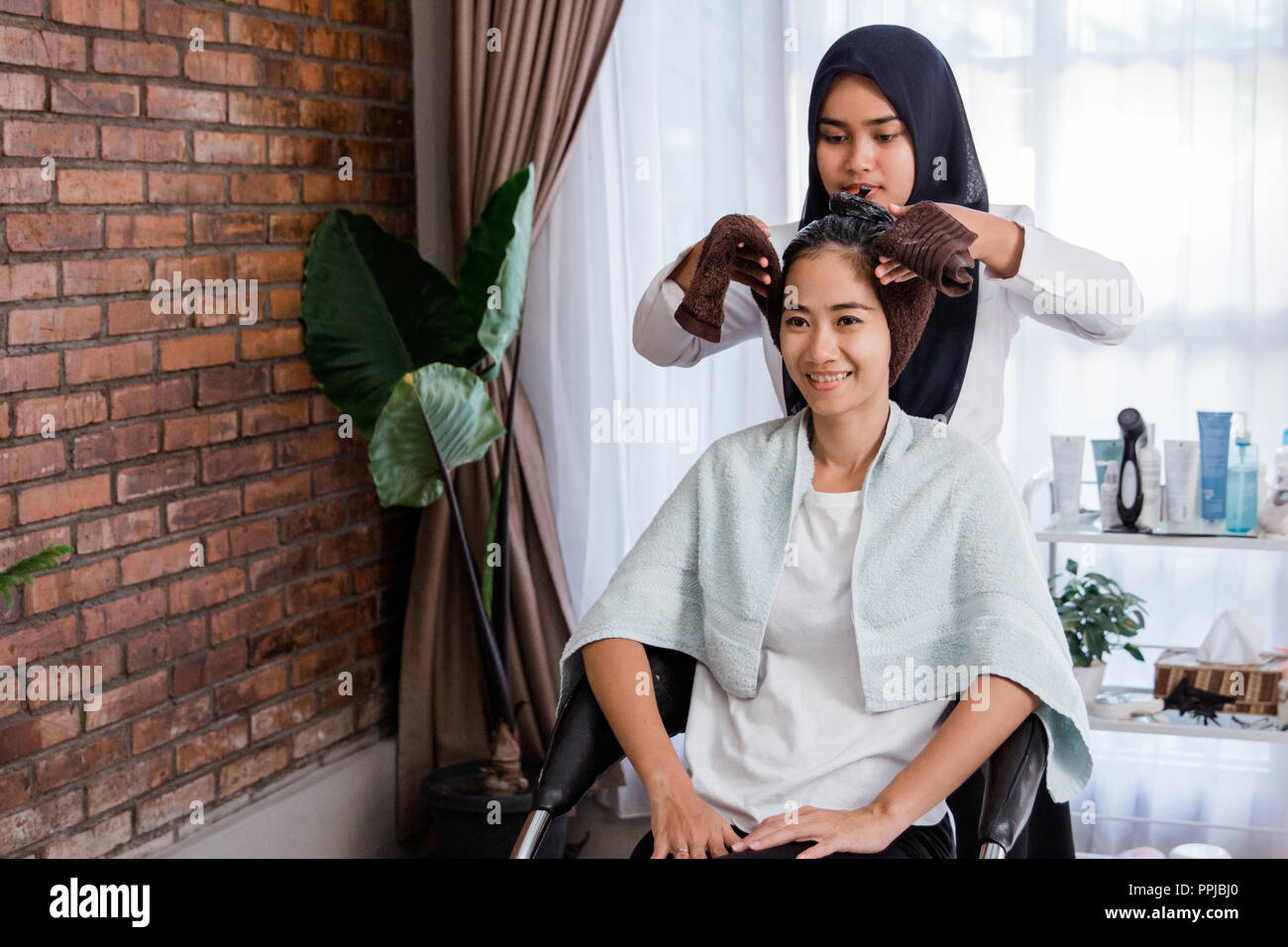 Woman Hair Treatment In Beauty Salon Stock Photo Alamy