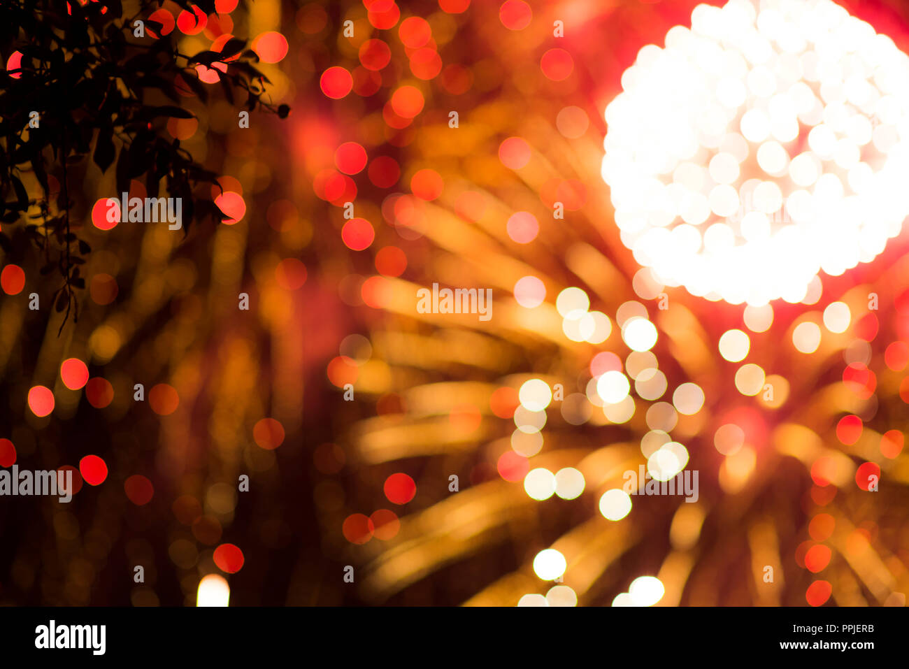 Colorful firework. Amazing fireworks with bokeh from drops on the lens, fireworks 2019, fireworks background, fireworks event, Celebration in the town Stock Photo
