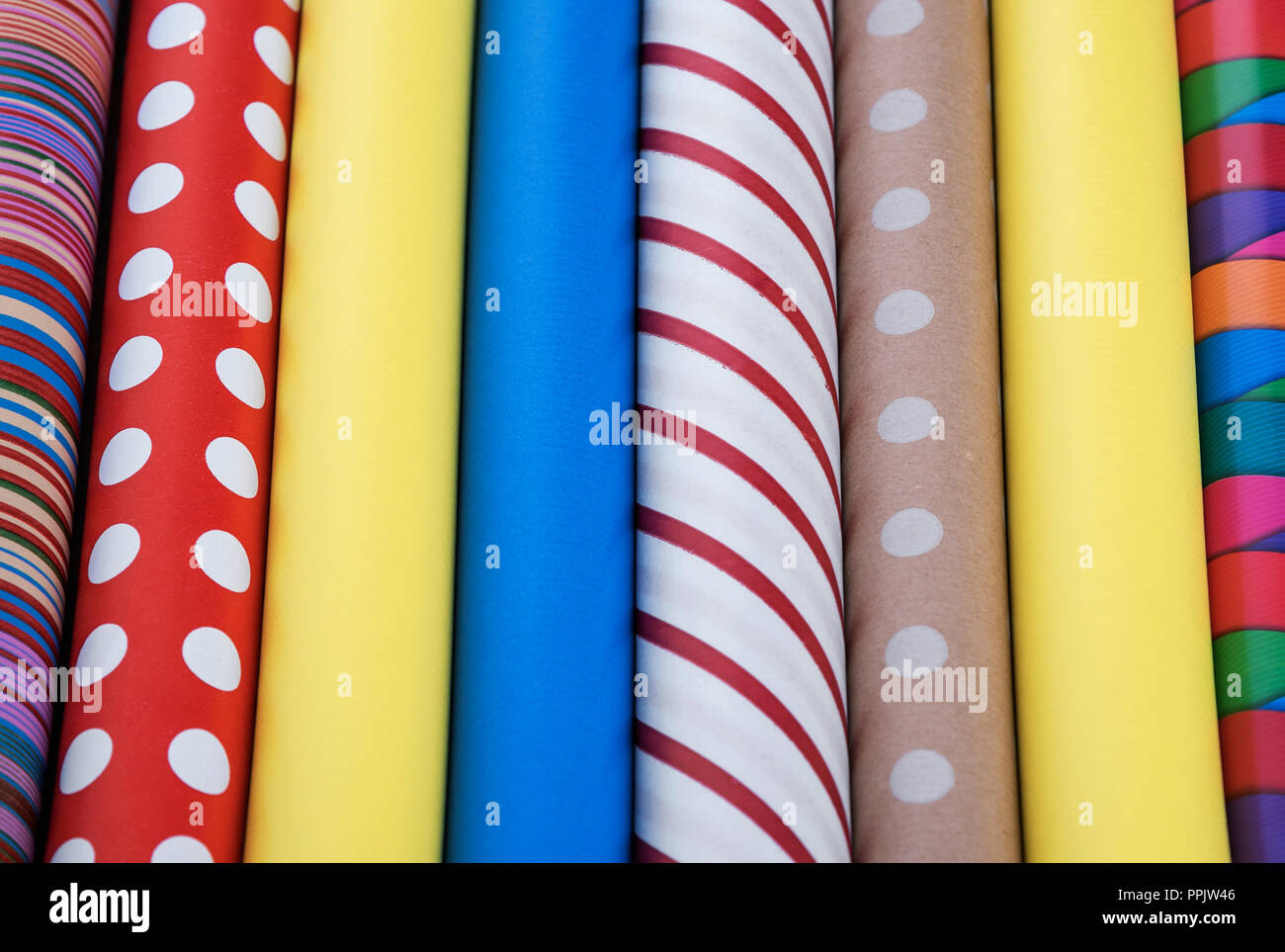Colorful paper for wrapping gifts. Preparing for a holiday. Stock Photo
