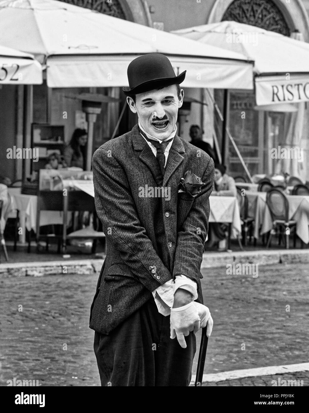 Italy, Rome, March 8/ 2018, Mime dressed as Charlie Chaplin in Piazza Navona (Navona Square) - Stock Image