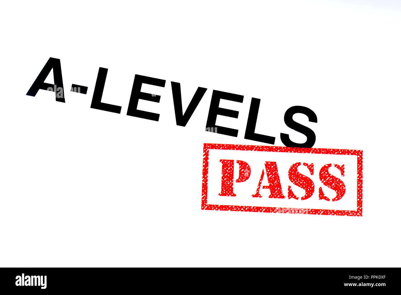 A-Levels heading stamped with a red PASS rubber stamp. - Stock Image