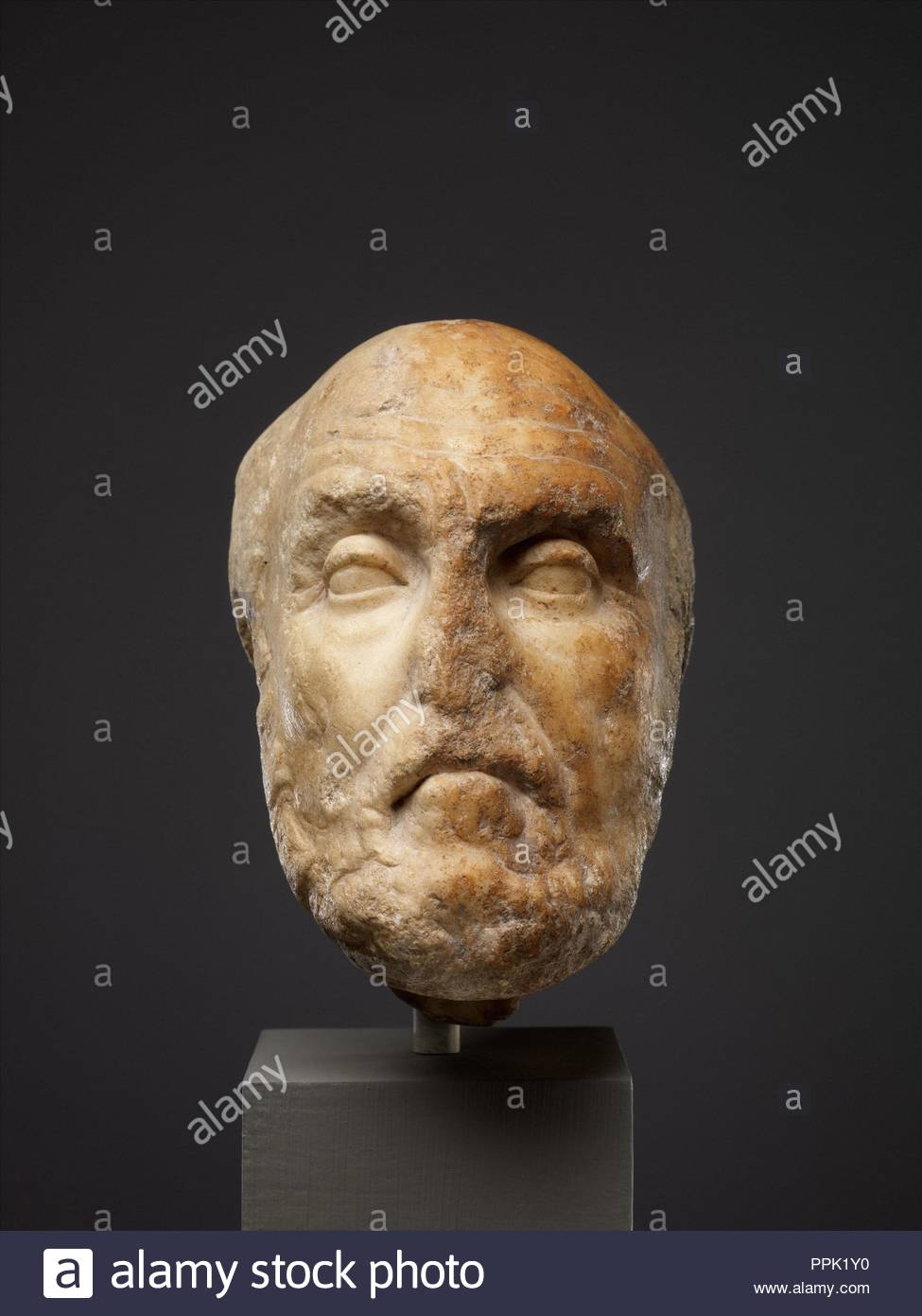 Marble portrait head of the philosopher Chrysippos, Early Imperial, 1st century A.D., Roman, Marble, 5 1/2 in. (14 cm), Stone Sculpture, Copy of a Greek statue of the late 3rd century B.C., probably by Euboulides. Chrysippos was one of the most important Stoic philosophers of the third century B.C. His writings helped establish Stoicism as a major philosophical movement. - Stock Image