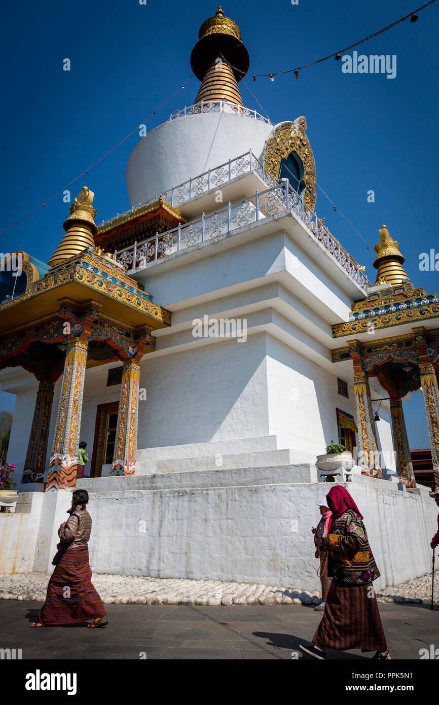Pilgrims circle the National Memorial Chorten in Thimpu, the capital city of the Himalayan Kingdom of Bhutan Stock Photo