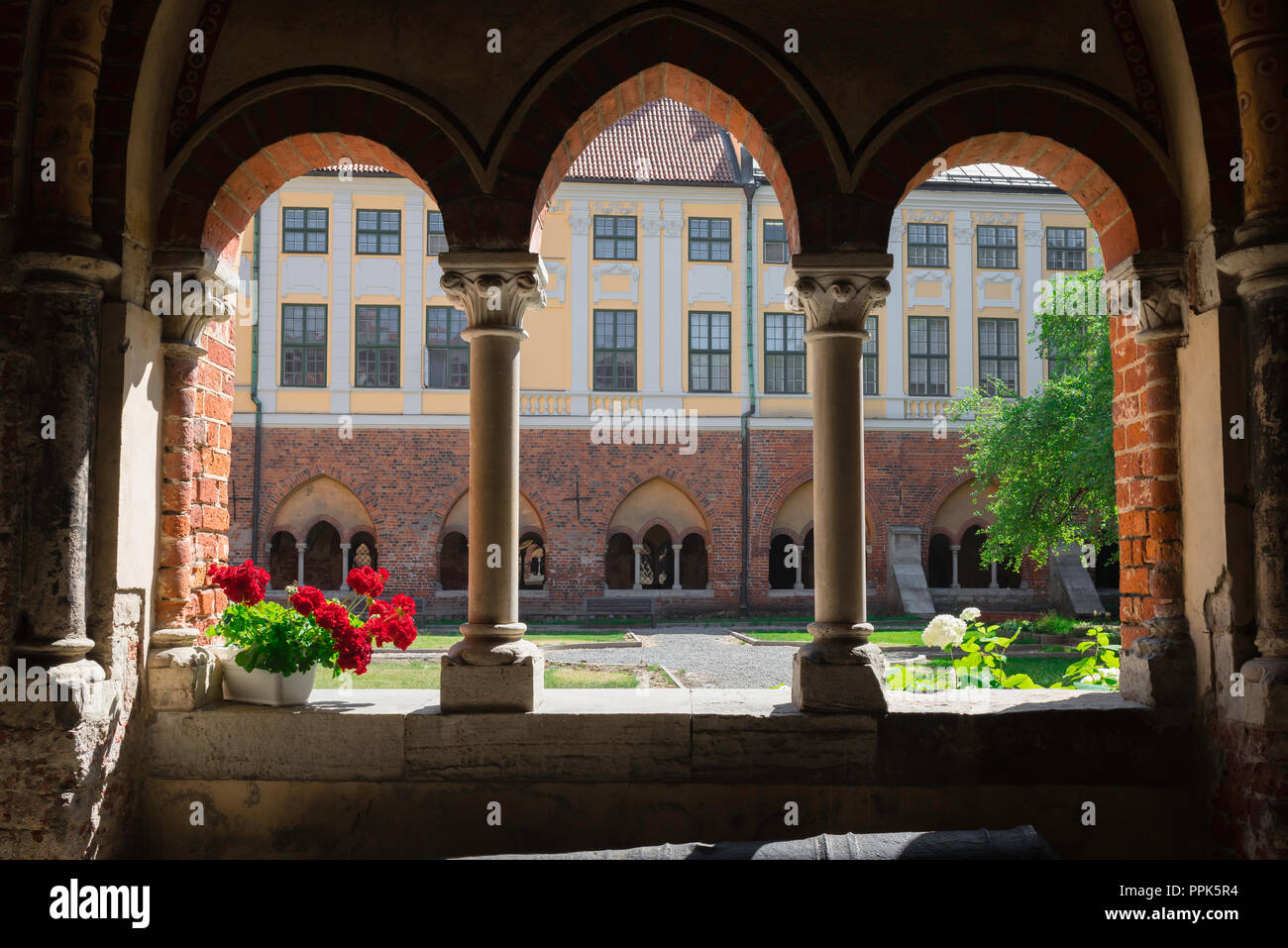 Cloister Riga Cathedral, view in summer from a medieval cloister window across the quadrangle garden of the city cathedral, Riga, Latvia. - Stock Image
