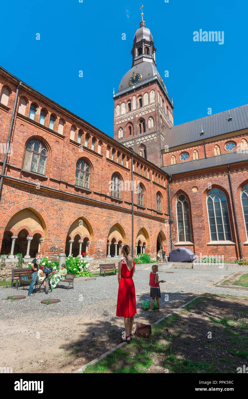 Riga Cathedral, view in summer of the cathedral tower and cloister from within the quadrangle garden, Riga, Latvia. - Stock Image