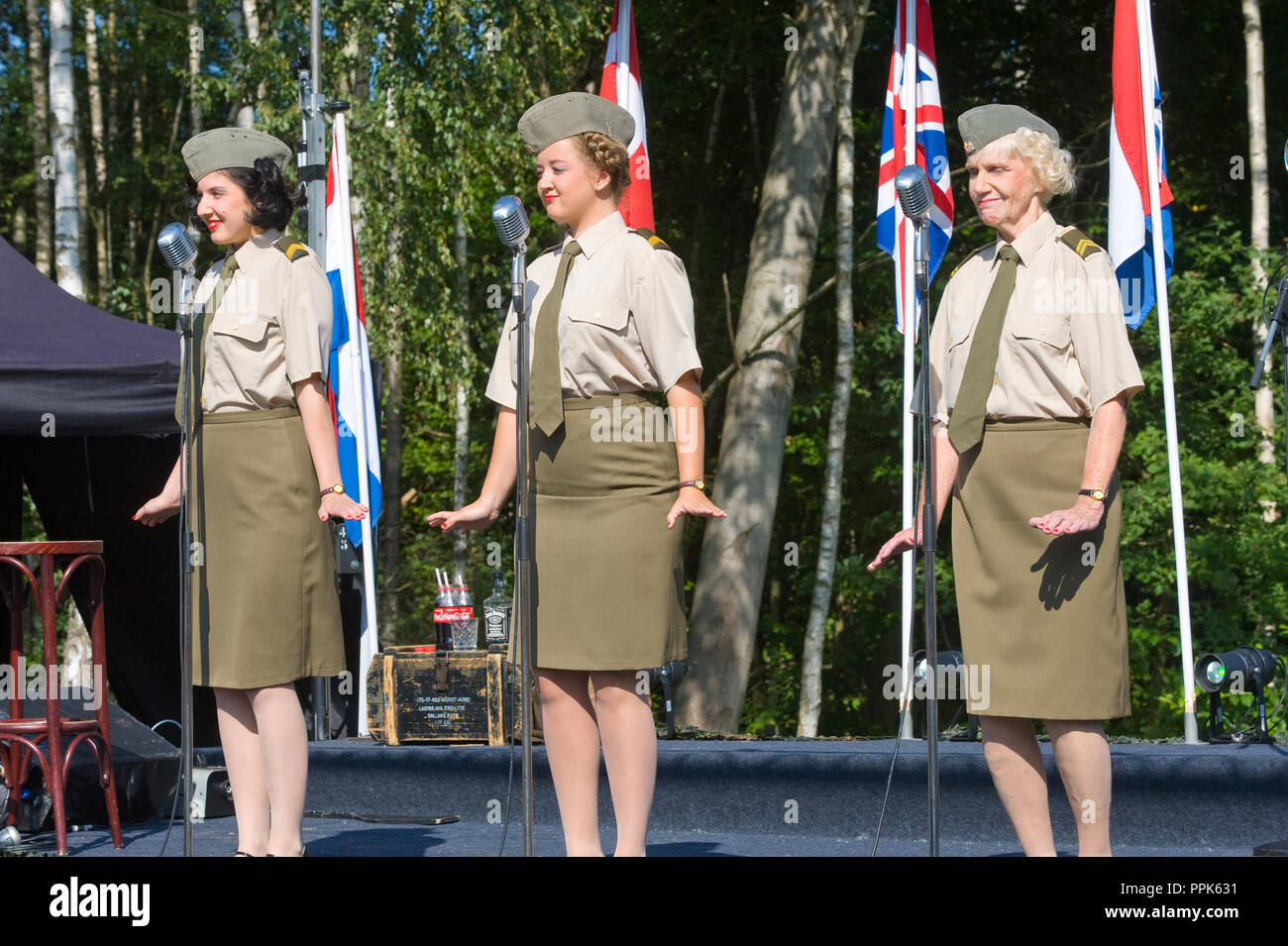 ENSCHEDE, THE NETHERLANDS - 01 SEPT, 2018: 'Sgt. Wilson's army show 'doing their stage act with historic forties songs during a military army show. - Stock Image
