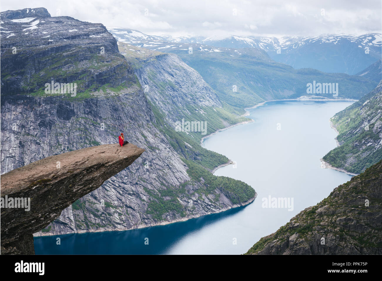 Perfect track adventure to Trolltunga. Amazing place with view of Ringedalsvatnet lake and mountains - Stock Image