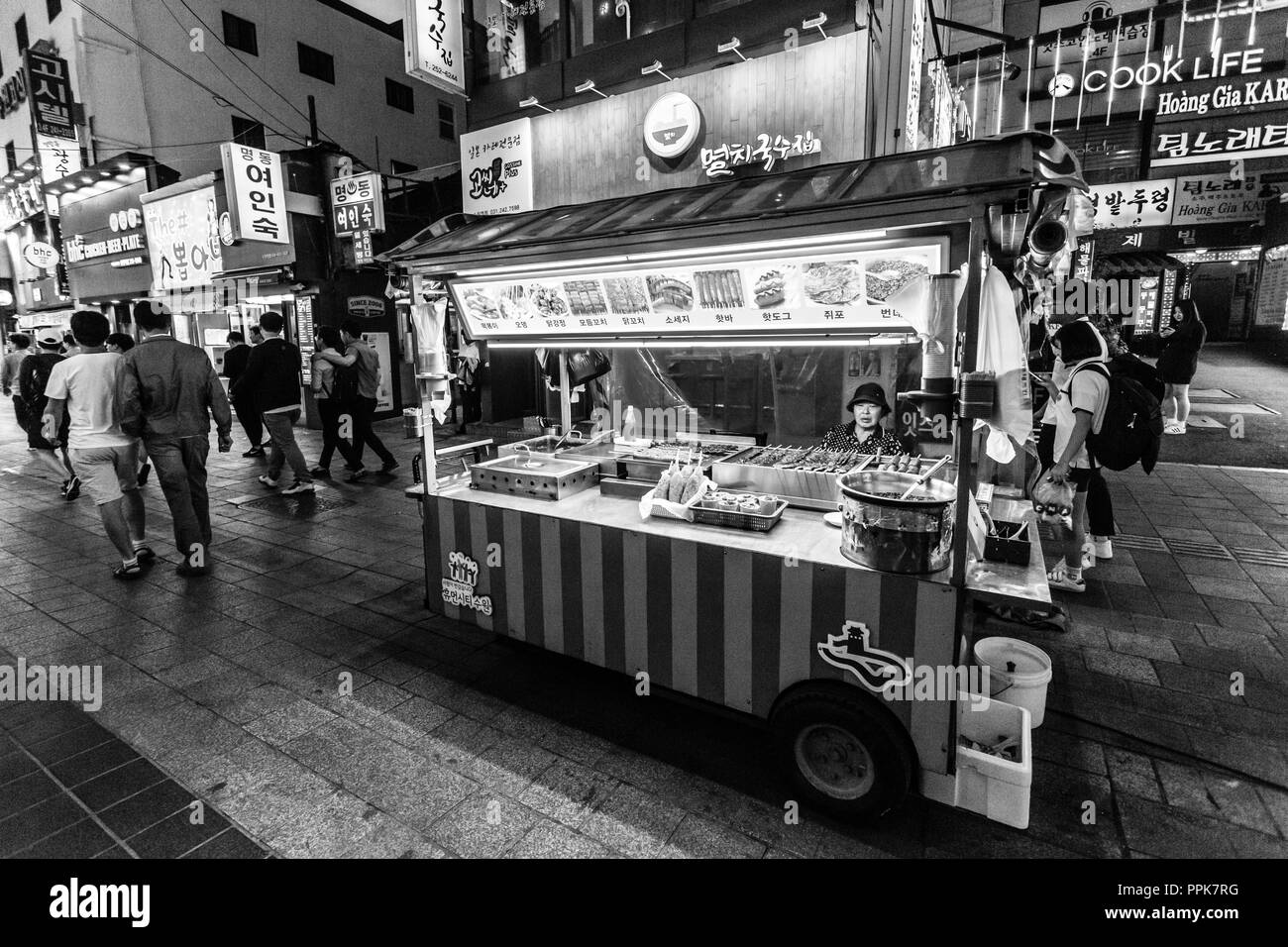 Suwon, South Korea - June 14, 2017: Vendor woman waiting of buyers in her fast food kiosk at main street in Suwon. - Stock Image