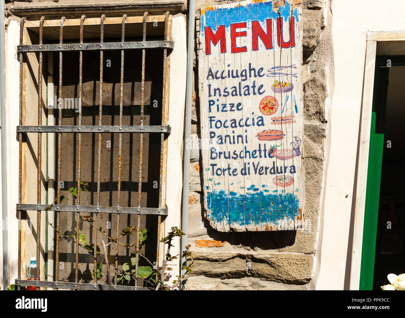 VERNAZZA, ITALY - APRIL 26 2011; Italian village typical pizzeria food shop signage  advertising different offerings with little pictures - Stock Image