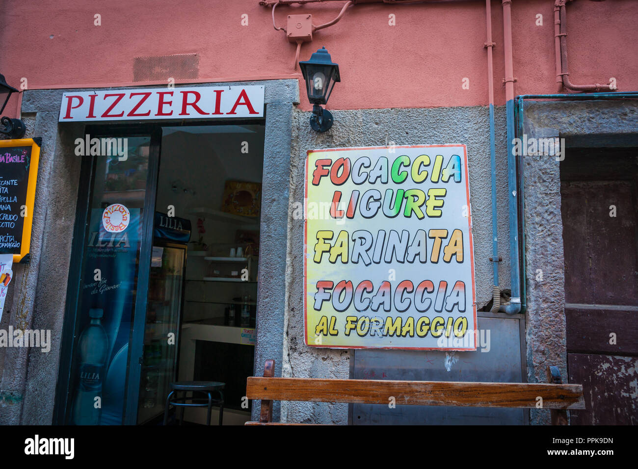 RIOMAGGIORE ITALY - APRIL 26 2011; Italian village typical pizzeria food shop signage  advertising different offerings - Stock Image