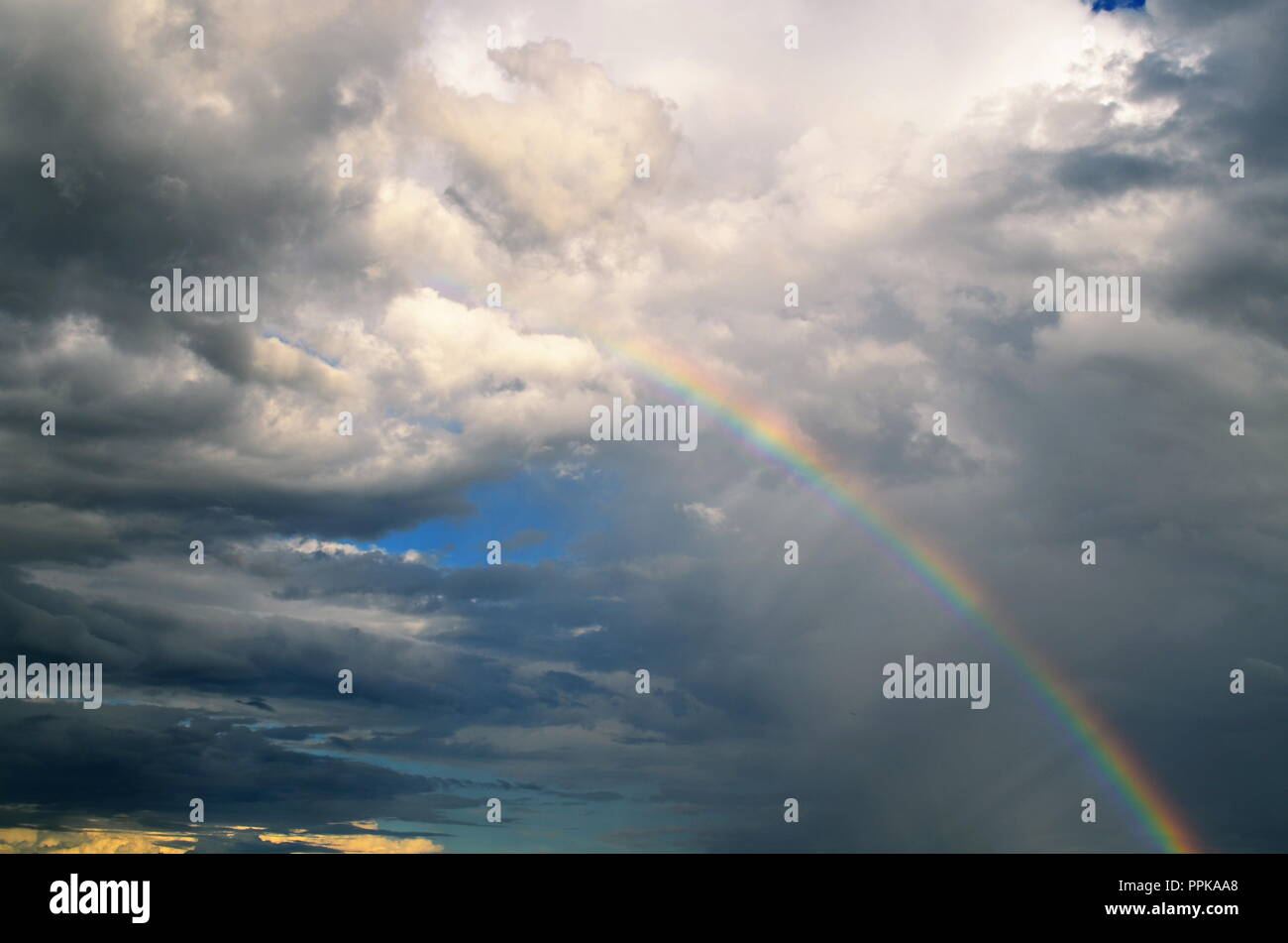 Rain clouds and a rainbow move though Austin, Texas - Stock Image