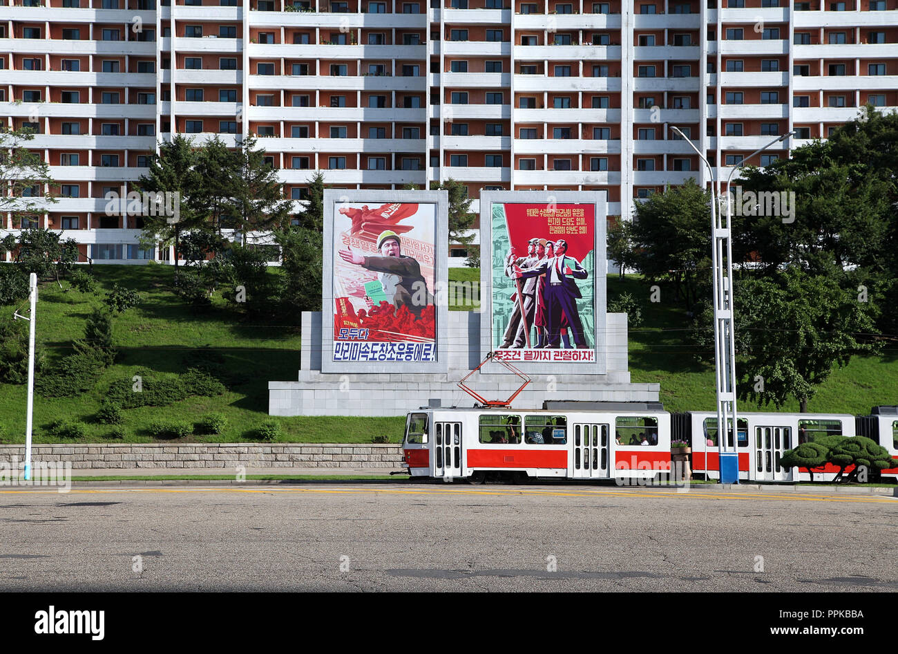 Huge propaganda murals in Pyongyang which are produced at Mansudae Art Studio - Stock Image