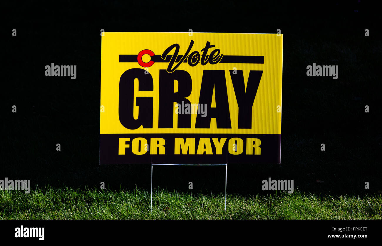 Political campaign sign placed on resident's front lawn urging neighbors to vote Gray for mayor. Castle Rock Colorado US. - Stock Image
