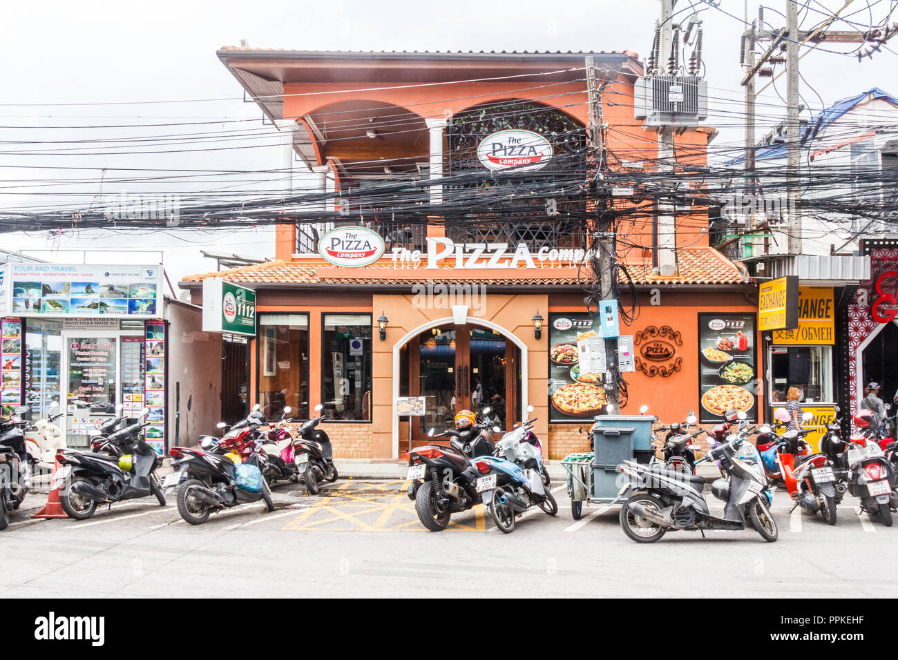 Patong, Thailand - 9th August 2018: The Pizza Company restaurant. The eating place is part of a chain serving and delivering pizzas. - Stock Image