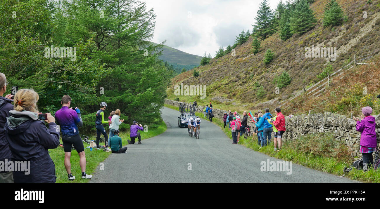 Stage 5 Tour of Britain 2018, Team Time Trial Whinlatter Pass. Spectators applaud & take photos as Team One Pro Cycling approach final uphill section. - Stock Image