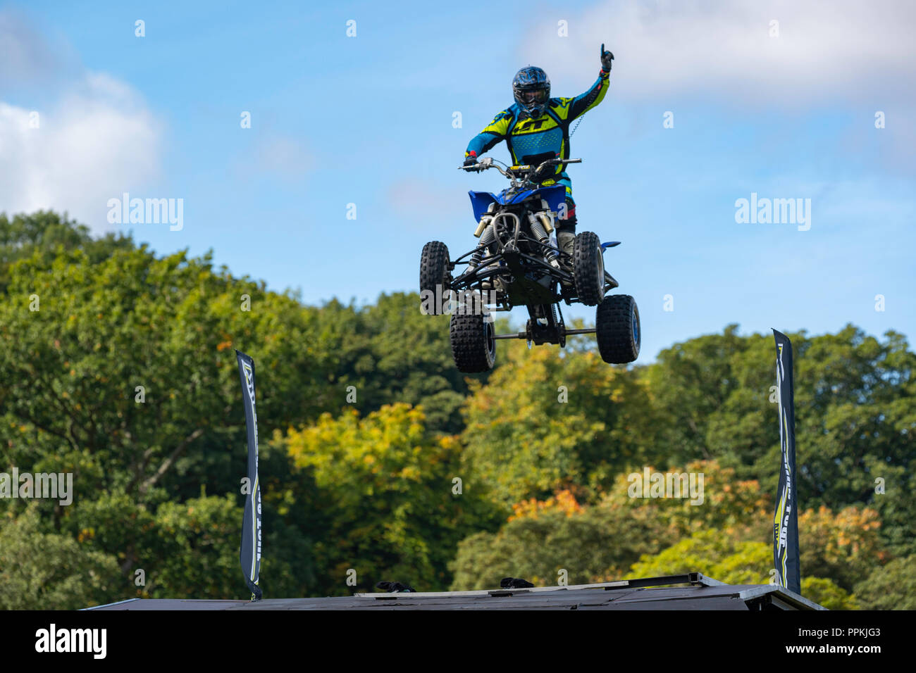 Quad Bike stuntman performing a mid-air jump at The Nidderdale Show,Pateley Bridge,North Yorkshire,England,UK. - Stock Image