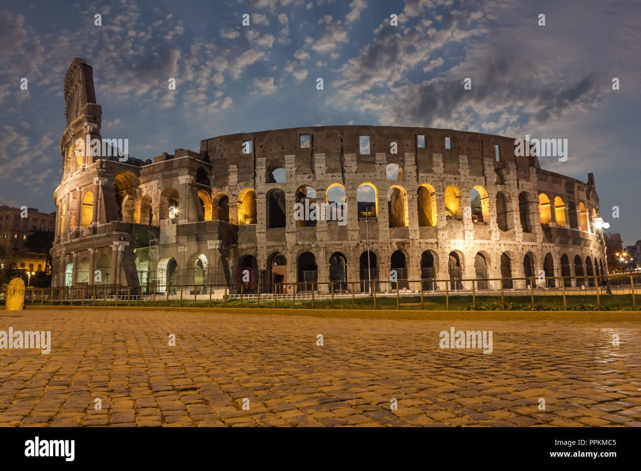 The Coliseum in the clouds in twilight - Stock Image