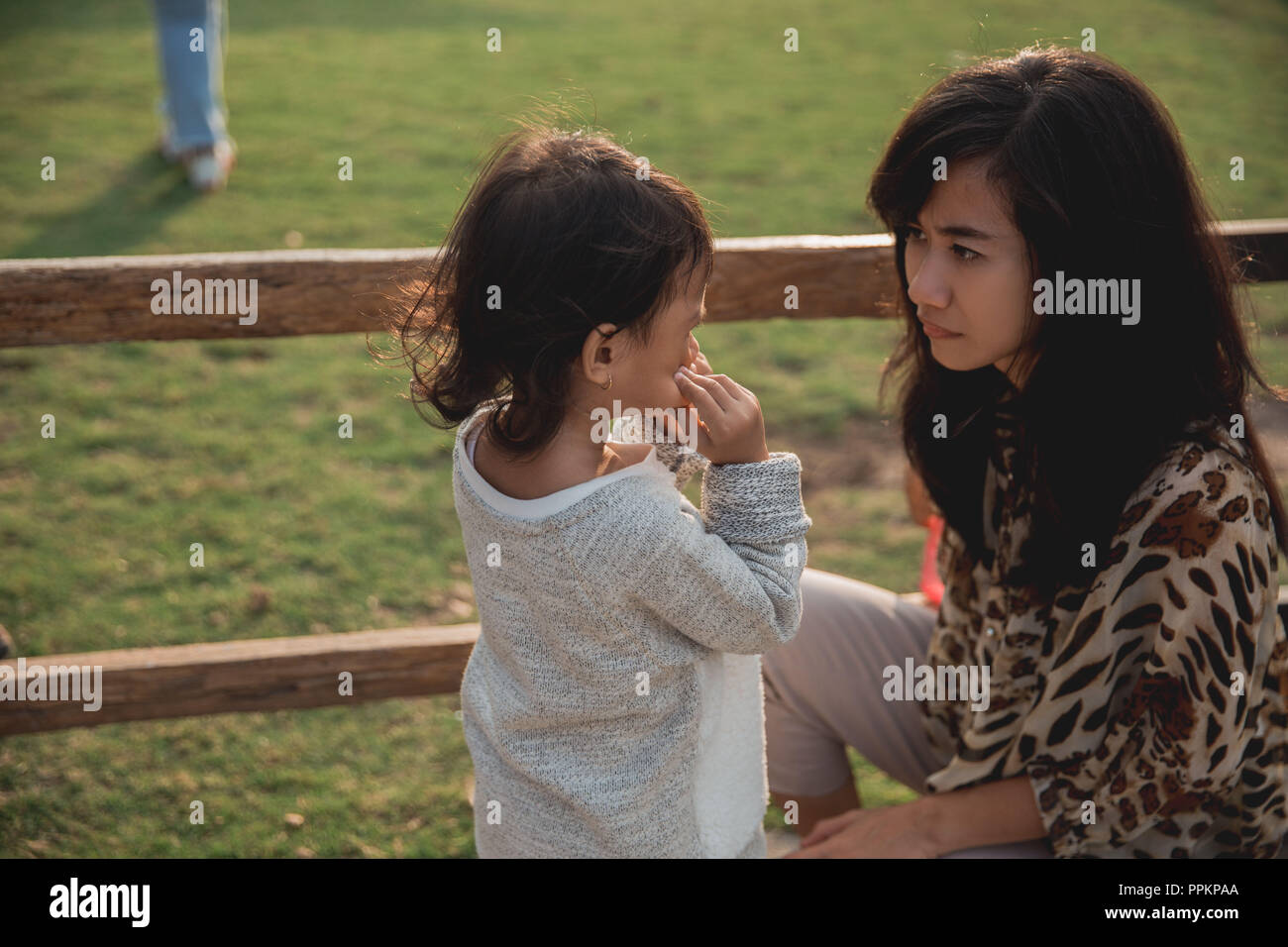 woman angry to her little daughter  - Stock Image