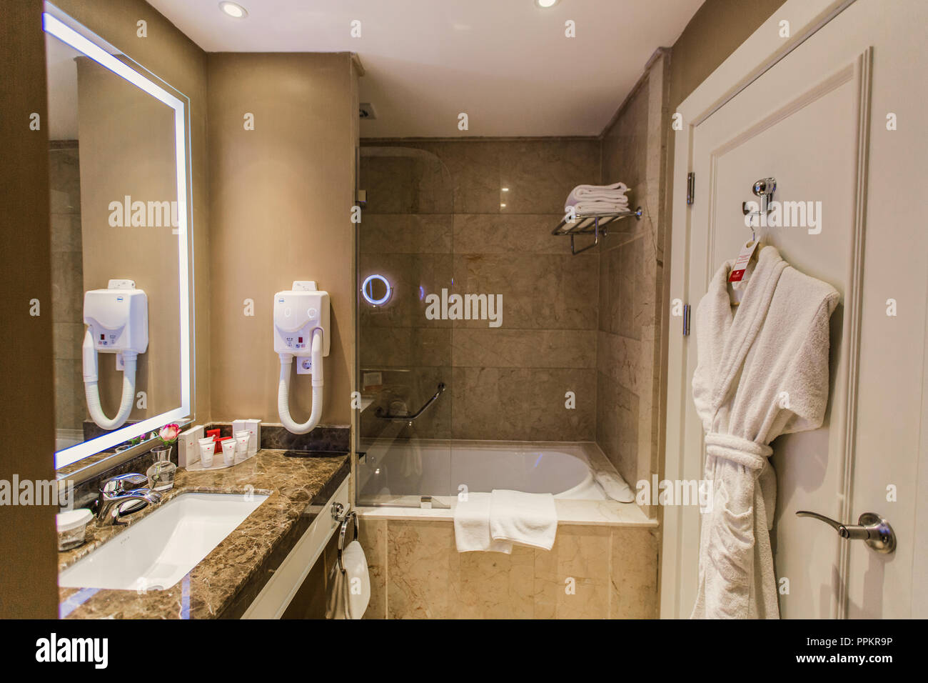 Shower, Bathroom In The Hotel   Bathroom Accessories, Hairdryer, Mirror  Over The Sink And Bathrobe On The Door, Background