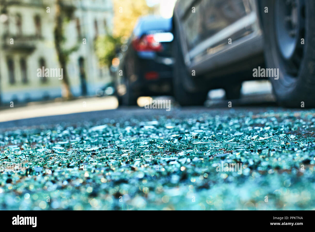 Shards of car glass on the street - Stock Image
