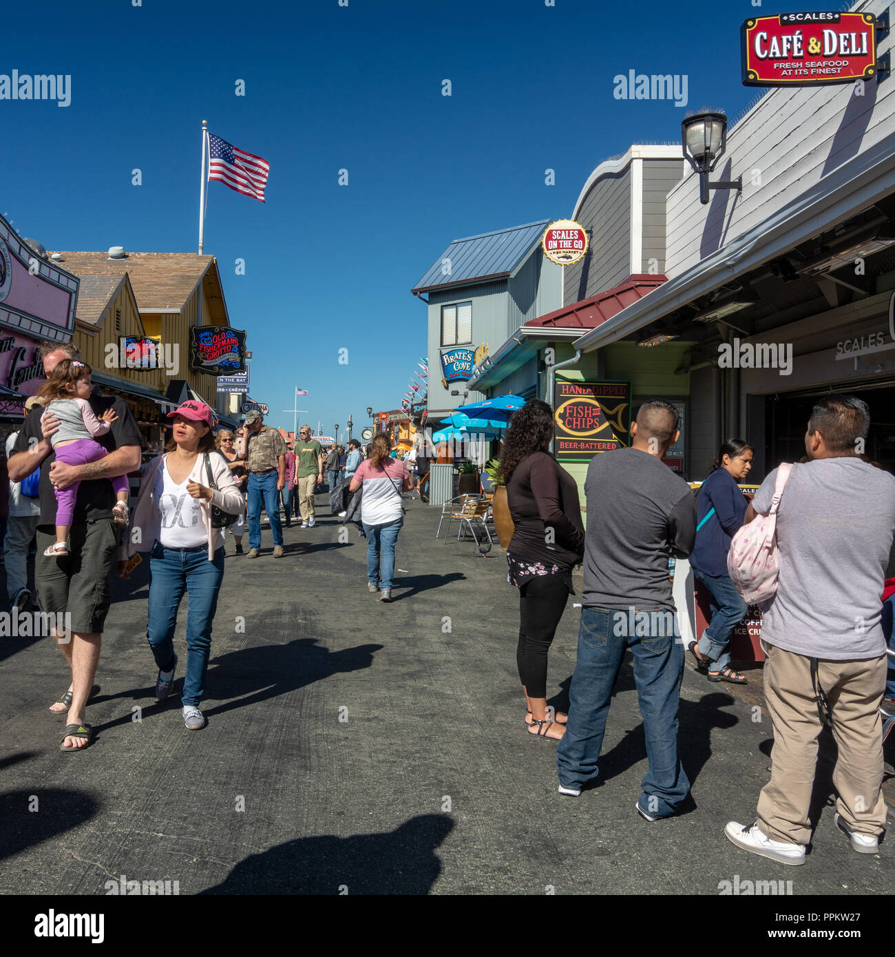 Monterey, CA, USA, 15 September  2018. Random tourists walking on Monterey pier 2, a tourist attraction, on a cloudless sky  day in the evening at the - Stock Image