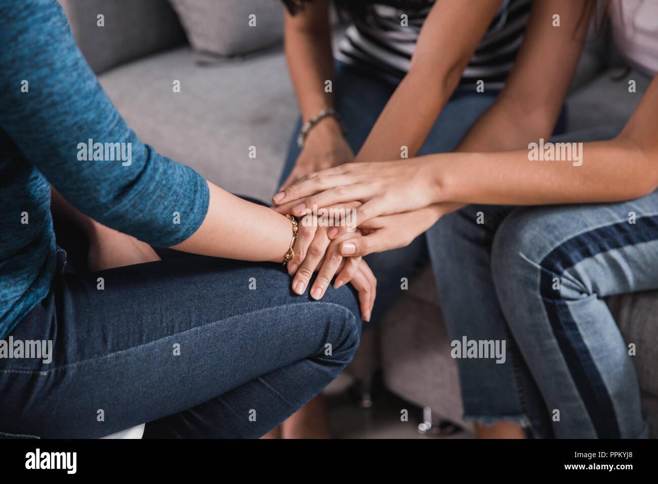 hand stack calming sad friend  - Stock Image