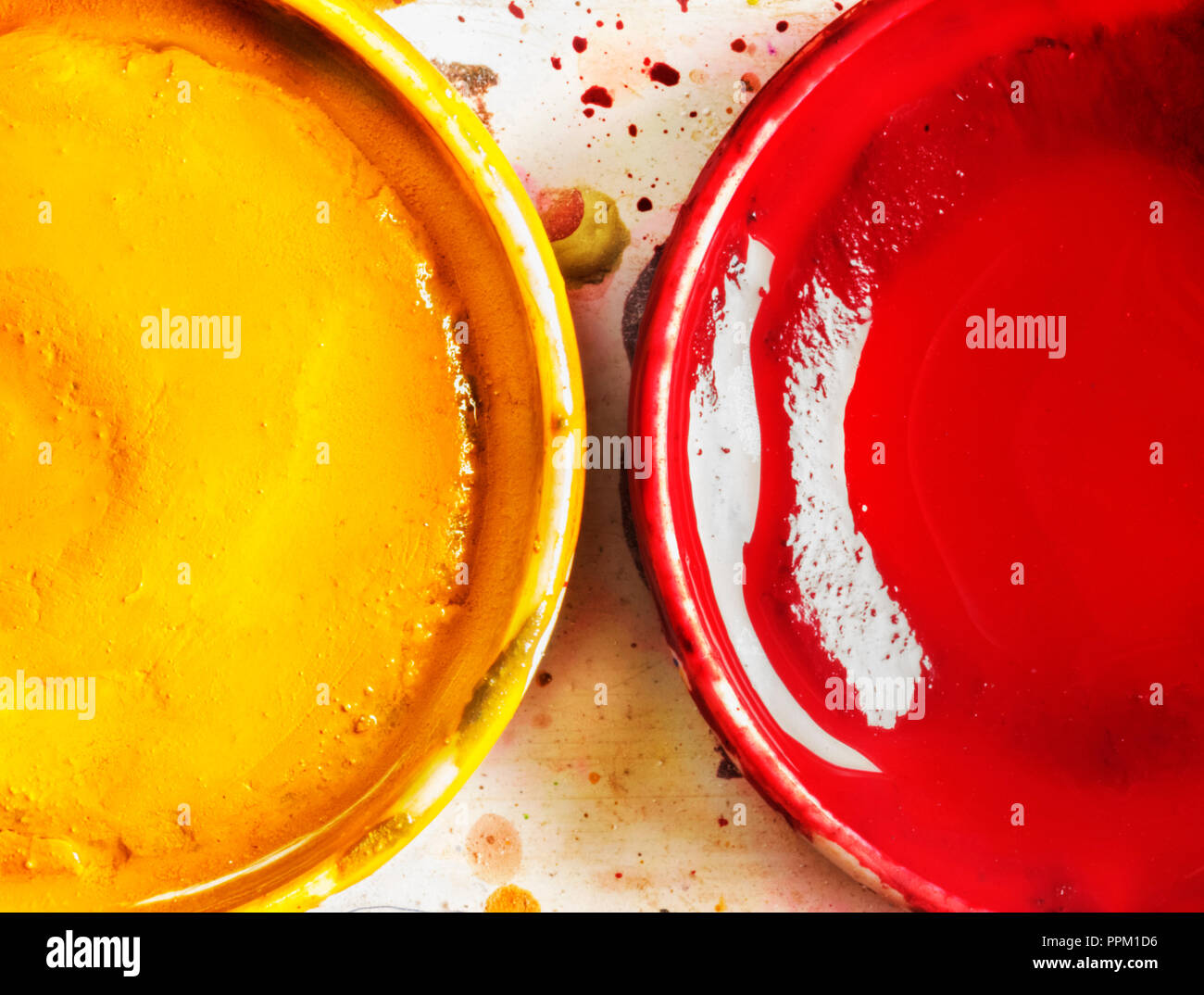 A small set of two watercolors , red and yellow colors in small round bowl , top view , - Stock Image
