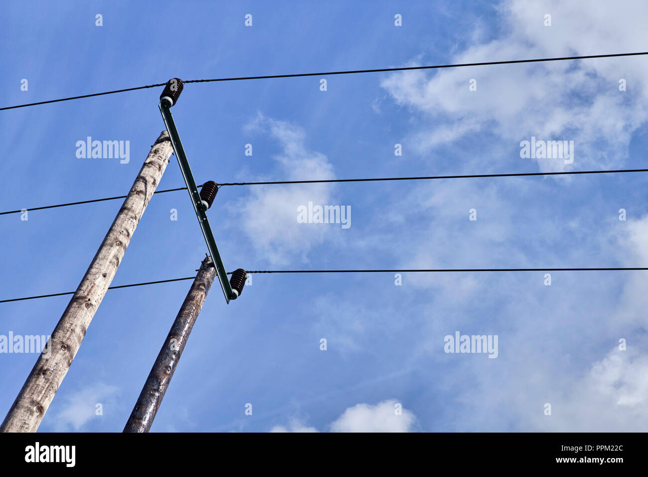 Looking up at electricity overhead cables on a pole - Stock Image