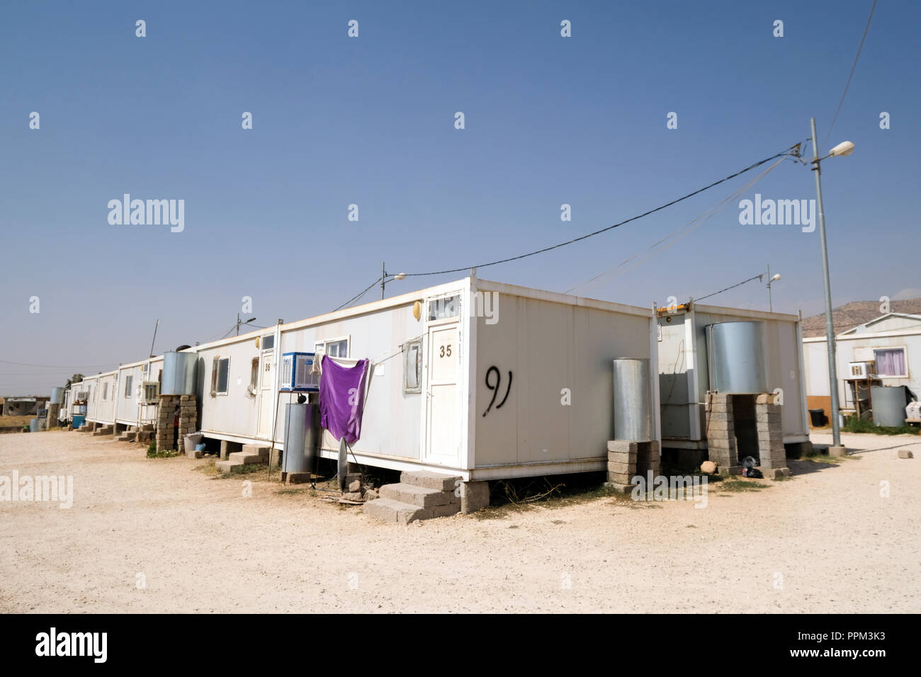 Container camp of Christian refugees in Seji, Iraq, Kurdistan Region - Containercamp christlicher Flüchtlinge in Seji, Irak, Region  Kurdistan - Stock Image