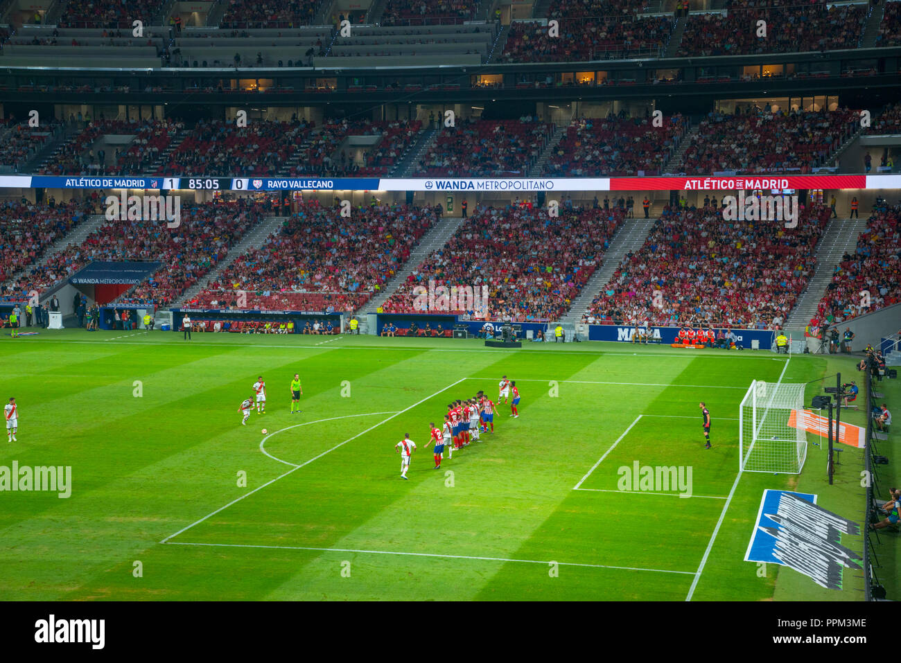 Free kick in football match. Wanda Metropolitano Stadium, Madrid, Spain. - Stock Image