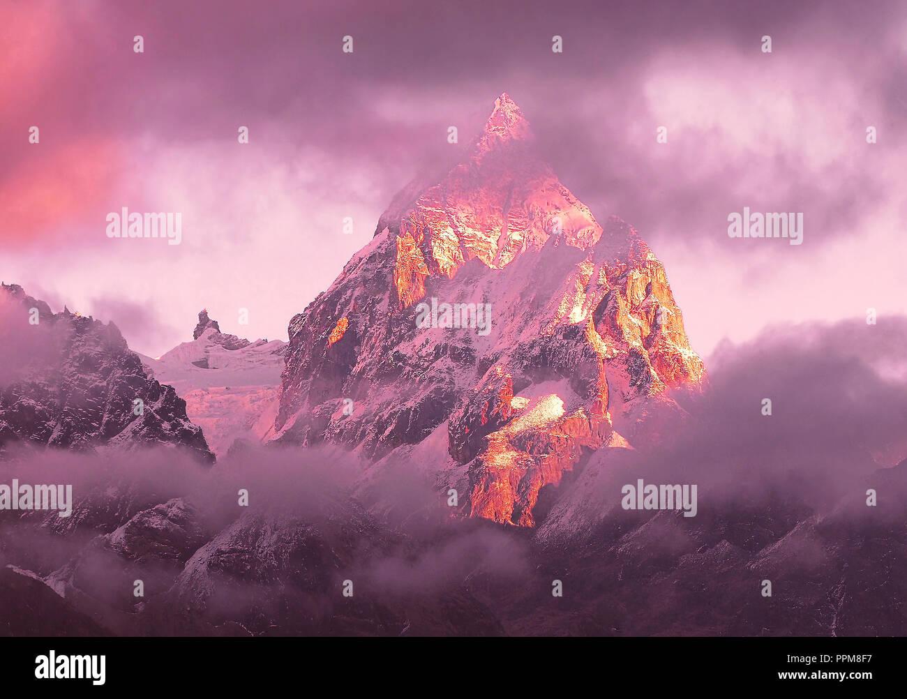 Magnificent view of Machermo peak (6,273 m) at sunset. Nepal, Himalayas. - Stock Image